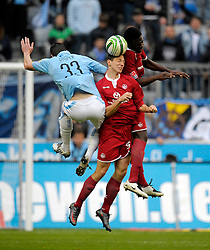 TSV 1860 Munich v FC Kaiserslautern,  Kenny Cooper (1860),  Jiri Bilek (Kaiserslautern) and Rodnei (Kaiserslautern) fight for the ball. 1st November 2009.