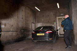 ©London News Picures. The car containing Julian Assange. Wikileaks's founder Julian Assange arriving at Westminster magistrate court in London on 7 December. Photo credit should read Fuat Akyuz/London News Pictures.
