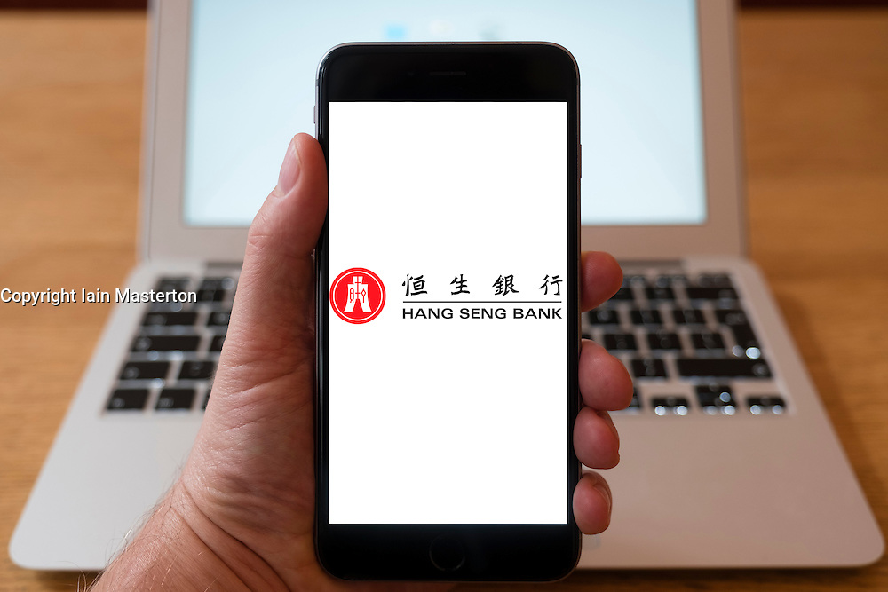 Using iPhone smartphone to display logo of Hang Seng Bank from Hong Kong