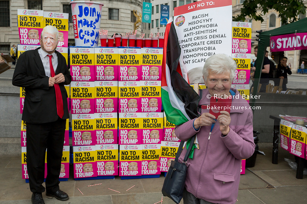 On US President Donald Trump's second day of a controversial three-day state visit to the UK, a Trump figure stands beside milkshakes, as protesters voice their opposition to the 45th American President, in Trafalgar Square, on 4th June 2019, in London England.