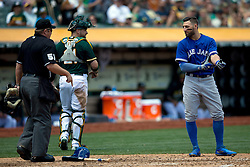 OAKLAND, CA - JULY 23:  Kevin Pillar #11 of the Toronto Blue Jays argues with umpire Marvin Hudson #51 after a called third strike during the fourth inning against the Oakland Athletics at O.co Coliseum on July 23, 2015 in Oakland, California. The Toronto Blue Jays defeated the Oakland Athletics 5-2. (Photo by Jason O. Watson/Getty Images) *** Local Caption *** Kevin Pillar; Marvin Hudson