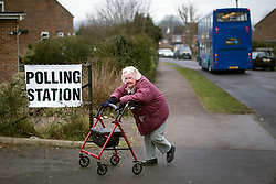 © London News Pictures. 28/02/2013 . Eastleigh, UK.   An elderly woman arriving at a polling station in Eastleigh, Hampshire to vote in the Eastleigh by-election on  Thursday, Feb. 28, 2013. The seat became vacant when Chris Hihne resigned following his guilty plea to a charge of perverting the course of justice. Photo credit : Ben Cawthra/LNP
