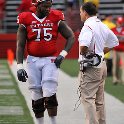 Sep 12, 2009; Piscataway, NJ, USA; Rutgers offensive lineman Anthony Davis (75) talks with head coach Greg Schiano during the second half of Rutgers' 45-7 victory over Howard in NCAA college football at Rutgers Stadium