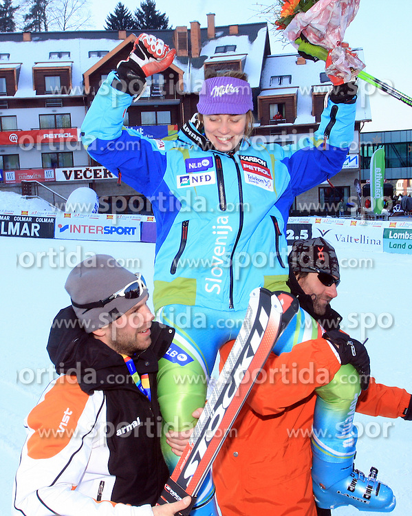 First placed after second run Tina Maze of Slovenia carried  by her coach Andrej Perovsek and Andrea Massi at Maribor women giant slalom race of Audi FIS Ski World Cup 2008-09, in Maribor, Slovenia, on January 10, 2009. (Photo by Vid Ponikvar / Sportida)