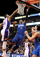 Dec. 09, 2012; Phoenix, AZ, USA; Orlando Magic forward Glen Davis (11) lays up the ball during the game against the Phoenix Suns forward Markieff Morris (11) in the first half at US Airways Center. Mandatory Credit: Jennifer Stewart-USA TODAY Sports.
