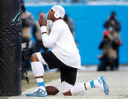CHARLOTTE, NC - JAN 24:  Quarterback Cam Newton #1 of the Carolina Panthers prays before the NFC Championship game against the Arizona Cardinals at Bank of America Stadium on January 24, 2016 in Charlotte, North Carolina.