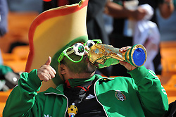 JOHANNESBURG, SOUTH AFRICA - Friday, June 11, 2010: A Mexico  supporter kisses the world cup trophy during the opening Group A match against Mexico during the 2010 FIFA World Cup South Africa at the Soccer City Stadium. (Pic by Hoch Zwei/Propaganda)