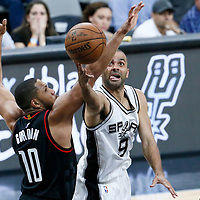 03 May 2017: San Antonio Spurs guard Tony Parker (9) goes for the layup against Houston Rockets guard Eric Gordon (10) during the San Antonio Spurs 121-96 victory over the Houston Rockets, in game 2 of the Western Conference Semi Finals, at the AT&T Center, San Antonio, Texas, USA.