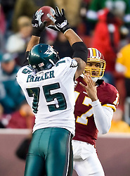 Philadelphia Eagles defensive end Juqua Parker (75) stuffs a pass attempt by Washington Redskins quarterback Jason Campbell (17).  The Washington Redskins defeated the Philadelphia Eagles 10-3 in an NFL football game held at Fedex Field in Landover, Maryland on Sunday, December 21, 2008.