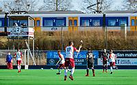 ALMERE - De trein passaat het hoofdveld van Almere tijdens de hoofdklasse hockeywedstrijd heren,  Almere- Amsterdam (1-3).    COPYRIGHT KOEN SUYK