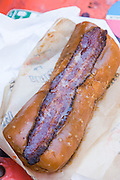 Glazed & Infused Maple Bacon Long John donut in Wicker Park August 2, 2015 in Chicago, Illinois, USA.