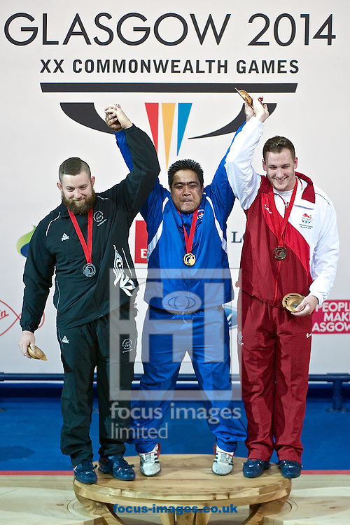 Stanislav Chalaev of New Zealand (Bronze medal), David Katoatau of Kiribati (Gold medal) and Ben Watson of England (Bronze medal) pictured after the Men's 105kg final on Weightlifting Day Seven at Clyde Auditorium during Glasgow 2014 Commonwealth Games <br /> Picture by Ian Wadkins/Focus Images Ltd +44 7877 568959<br /> 30/07/2014
