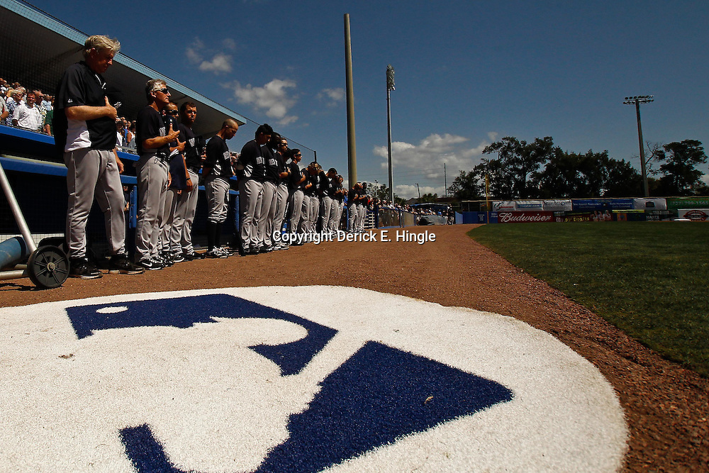 March 8, 2011; Dunedin, FL, USA; New York Yankees players and staff stand for the national anthem before a spring training game against the Toronto Blue Jays at Florida Auto Exchange Stadium. Mandatory Credit: Derick E. Hingle-US PRESSWIRE