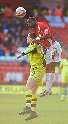 LONDON, ENGLAND - Saturday, January 30, 2010: Charlton Athletic's Sam Sodje rises highest in the air against Tranmere Rovers' Terry Gornell during the Football League One match at the Valley. (Photo by Gareth Davies/Propaganda)