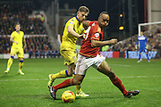 Nottingham Forest forward, on loan from Brighton & Hove albion, Chris O'Grady watched by Leeds United defender Charlie Taylor  during the Sky Bet Championship match between Nottingham Forest and Leeds United at the City Ground, Nottingham, England on 27 December 2015. Photo by Simon Davies.