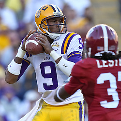 November 6, 2010; Baton Rouge, LA, USA;  LSU Tigers quarterback Jordan Jefferson (9) is pressured by Alabama Crimson Tide cornerback Robert Lester (37) during the second half at Tiger Stadium. LSU defeated Alabama 24-21.  Mandatory Credit: Derick E. Hingle
