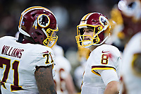NEW ORLEANS, LA - NOVEMBER 19:  Kirk Cousins #8 talks with Trent Williams #71 of the Washington Redskins during a game against the New Orleans Saints at Mercedes-Benz Superdome on November 19, 2017 in New Orleans, Louisiana.  Saints defeated the Redskins 34-31.  (Photo by Wesley Hitt/Getty Images) *** Local Caption *** Kirk Cousins; Trent Williams