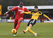 Robert Harris crosses the ball ahead of Mathias Pogba during the Sky Bet League 1 match between Crawley Town and Sheffield Utd at Broadfield Stadium, Crawley, England on 28 February 2015. Photo by David Charbit.