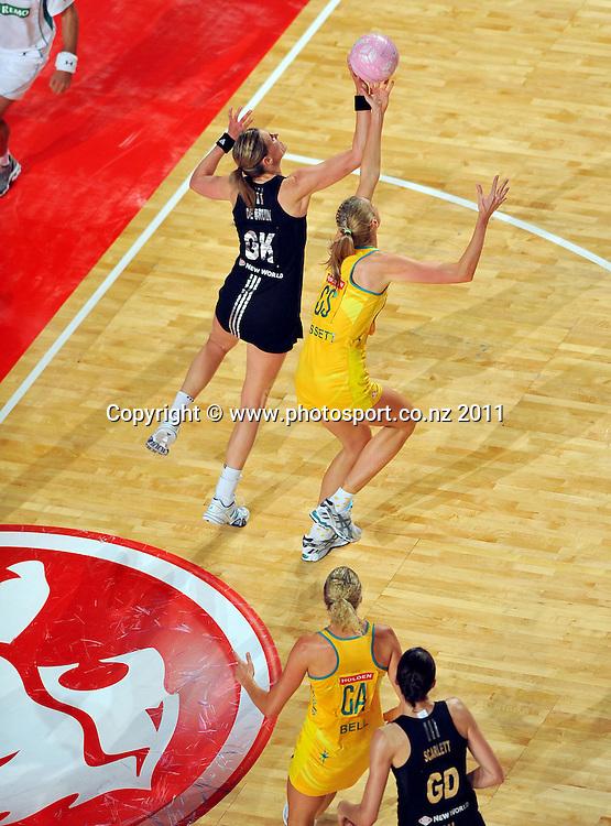 Leana DeBruin (NZ) - Caitlin Bassett (AUS)<br /> 2011 Holden Netball Test Series<br /> Australia vs New Zealand <br />  Sunday 30 October 2011<br /> Hisense Arena/ Melbourne Australia <br /> &copy; Sport the library / Jeff Crow