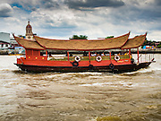 14 SEPTEMBER 2016 - BANGKOK, THAILAND: A converted rice barge takes tourists on a cruise on the Chao Phraya River in Bangkok.      PHOTO BY JACK KURTZ