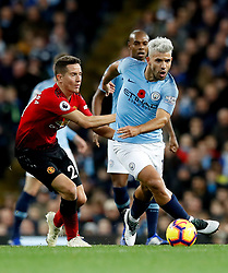 """Manchester City's Sergio Aguero (right) and Manchester United's Ander Herrera (left) battle for the ball during the Premier League match at the Etihad Stadium, Manchester. PRESS ASSOCIATION Photo. Picture date: Sunday November 11, 2018. See PA story SOCCER Man City. Photo credit should read: Martin Rickett/PA Wire. RESTRICTIONS: EDITORIAL USE ONLY No use with unauthorised audio, video, data, fixture lists, club/league logos or """"live"""" services. Online in-match use limited to 120 images, no video emulation. No use in betting, games or single club/league/player publications."""