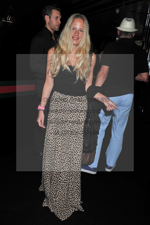 ASTRID HARBORD at a party to launch the Gucci designed Fiat 500 customized by Gucci Creative Director Frida Giannini in collaboration with FIAT's Centro Stile, held at Fiat, 105 Wigmore Street, London on 27th June 2011.