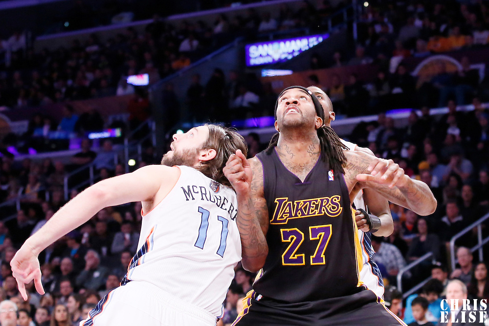 31 January 2014: Los Angeles Lakers power forward Jordan Hill (27) vies for the rebound with Charlotte Bobcats power forward Josh McRoberts (11) during the Charlotte Bobcats 110-100 victory over the Los Angeles Lakers at the Staples Center, Los Angeles, California, USA.