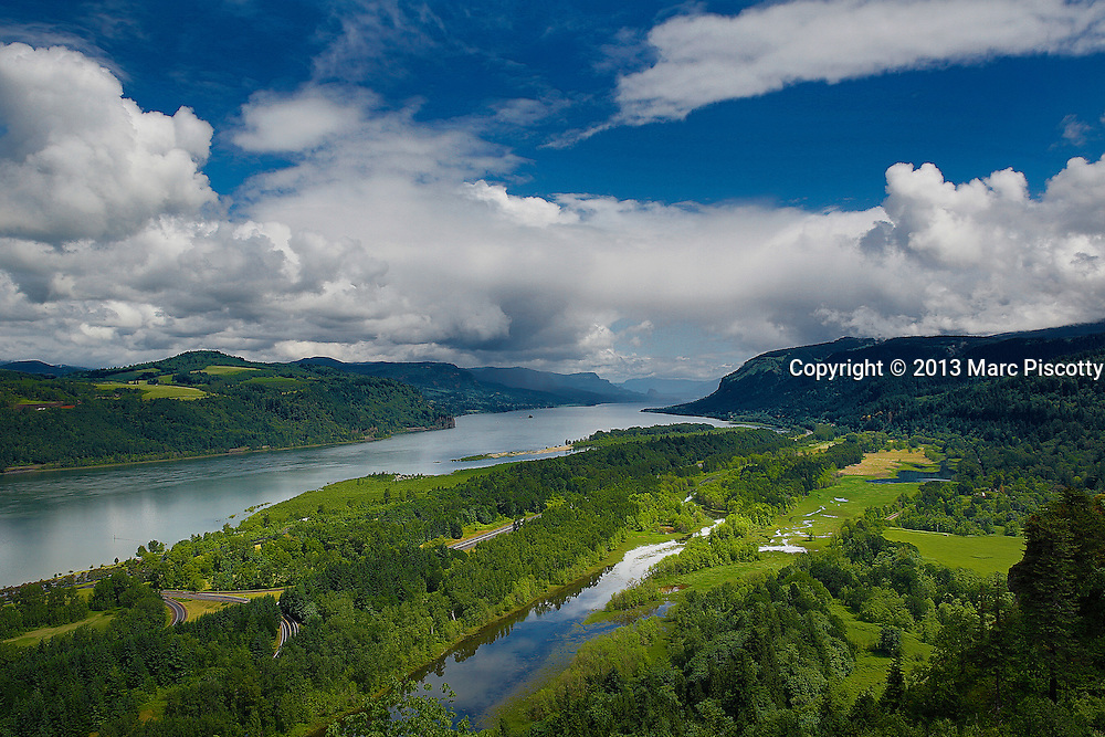 SHOT 5/30/13 1:38:09 PM - The Columbia River Gorge is a canyon of the Columbia River in the Pacific Northwest of the United States. Up to 4,000 feet (1,200 m) deep, the canyon stretches for over 80 miles (130 km) as the river winds westward through the Cascade Range forming the boundary between the State of Washington to the north and Oregon to the south. Extending roughly from the confluence of the Columbia with the Deschutes River down to eastern reaches of the Portland metropolitan area, the gorge furnishes the only navigable route through the Cascades and the only water connection between the Columbia River Plateau and the Pacific Ocean.<br /> The gorge holds federally protected status as a National Scenic Area called the Columbia Gorge National Scenic Area and is managed by the Columbia River Gorge Commission and the US Forest Service. The gorge is a popular recreational destination. Oregon is a state in the Pacific Northwest region of the United States. Oregon is the 9th most expansive and the 27th most populous of the 50 United States. (Photo by Marc Piscotty / &copy; 2013)
