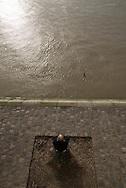 France. paris. 4th district.  people gathering at sunset on the quai  d orleans along the seine river , on saint louis island, in the distance, the right bank  / rassemblement au coucher du soleil sur le quai d orleans sur  ile saint louis paris