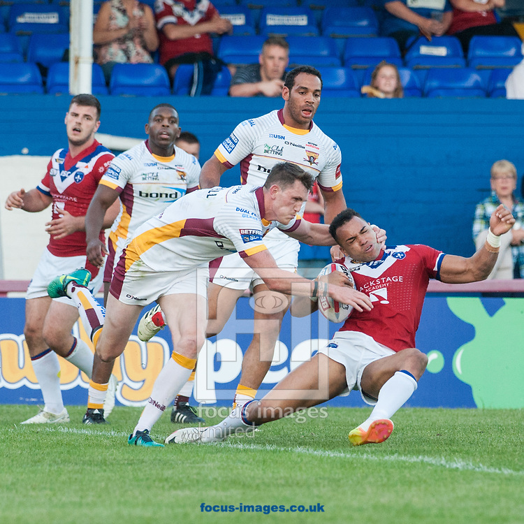 Jordan Crowther of Wakefield Trinity is tackled by Lee Gaskell of Huddersfield Giants during the Betfred Super League match at Belle Vue, Wakefield<br /> Picture by Matt Wilkinson/Focus Images Ltd 07814 960751<br /> 26/05/2017