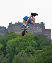 Pictured: Acrobat Jarno Polhuijs practices his skills with Edinburgh Castle as a backdrop.<br /> <br /> Finnish circus stars Race Horse Company limber up for this years Edinburgh Festival Fringe in the Meadows.<br /> <br /> © Dave Johnston / EEm