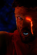 A war-torn Spartan with a bandaged eye bleeds glowing blood from his wound.Black light