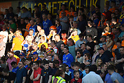 The Oldham fans illuminated by a shaft of sunlight during the EFL Sky Bet League 1 match between Northampton Town and Oldham Athletic at Sixfields Stadium, Northampton, England on 5 May 2018. Picture by Dennis Goodwin.