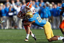 Dec 31, 2011; San Francisco CA, USA; Illinois Fighting Illini kicker Derek Dimke (13) is tackled by UCLA Bruins linebacker Glenn Love (20) during a fake field goal attempt during the second quarter at AT&T Park. Illinois defeated UCLA 20-14. Mandatory Credit: Jason O. Watson-US PRESSWIRE