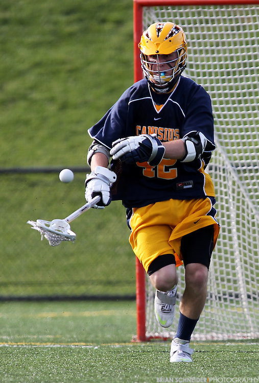 May 12, 2012; Baltimore, MD, USA; Canisius College Golden Griffins midfielder Brendan Murphy (42) gets a ground ball against Loyola Maryland Greyhounds at Ridley Athletic Complex in Baltimore, MD. Mandatory Credit: Brian Schneider-www.ebrianschneider.com