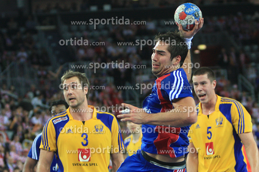 Nikola Karabatic (13) of France during 21st Men's World Handball Championship 2009 Main round Group I match between National teams of France and Sweden, on January 24, 2009, in Arena Zagreb, Zagreb, Croatia.  (Photo by Vid Ponikvar / Sportida)