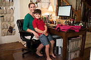 Molly Goodall poses for a portrait with her son, Carter, at her desk where she designs children's jackets at her home in McKinney, Texas on September 11, 2015. (Cooper Neill for The New York Times)