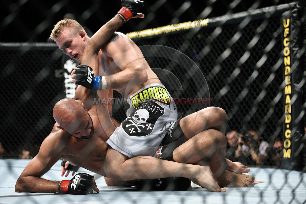 "LONDON, ENGLAND, OCTOBER 2010: Alexander Gustafsson (top) works to keep Cyrille Diabate down on the canvas during ""UFC 120: Bisping vs. Akiyama"" inside the O2 Arena in Greenwich, London"