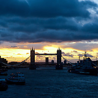 A beautiful golden sunrise on a stormy day in London. View on the river Thames and Tower Bridge