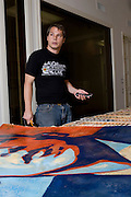 Los Angeles, California: artist Shepard Fairey signs prints in his studio in the Echo Park district of Los Angeles, 7/14/08.