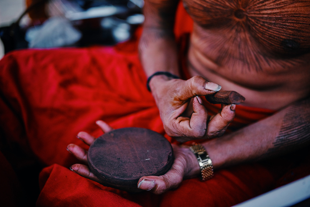 The sadhu from the state of Madhya Pradesh used this(a wooden piece) to draw all lines on his body. He was a follower of Goddess Kali and was living in his own vehicle during the Kumbh Mela.