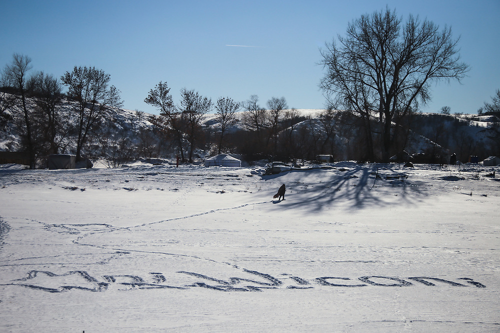 A man walks across the frozen Cannonball River where the phrase, &quot;Mni Wiconi,&quot; translating to &quot;Water is life,&quot; is engraved in footprint at the Oceti Oyate Camp in Cannon Ball, North Dakota in January 2017.<br /> <br /> The US Army Corps of Engineers granted the final easement needed to complete the construction of the controversial Dakota Access Pipeline in a court filing on February 7th, 2017. An environmental impact statement that was delaying efforts to grant an easement was also terminated by the Army Corps.