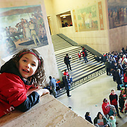 Emi Bursett, 6, looking over the edge of the Capitol Rotunda.<br /> Thousands of educators and their supporters from all over the state gather at the Oregon State Capitol to rally for adequate school funding. A select group of teachers and staff members spoke to Gov. Kate Brown about their experiences, and shared with her the challenges of being a teacher today.<br /><br />Photography by Thomas Patterson.