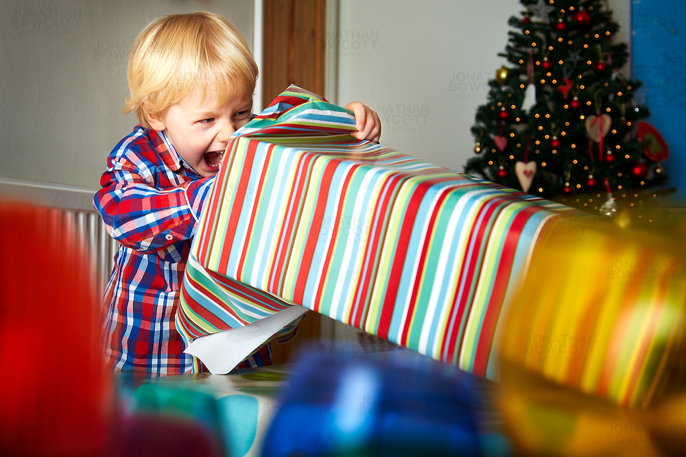 Finn, a 4 year old boy from Bristol, unwraps a present on Christmas Day 2011. His reaction is just what you want to see - joy, excitement, innocence & wonder. No cynicism, no agenda, no worries. Merry Christmas.