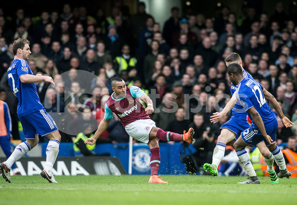 Winston Reid of West Ham United shoots late in the second half during the Barclays Premier League match between Chelsea and West Ham United at Stamford Bridge, London, England on 19 March 2016. Photo by Steve Ball.