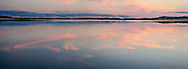 Clouds reflect in the still water of the upper reaches of Wellfleet Harbor.