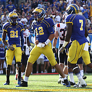 Delaware quarter back Trent Hurley #12 celebrates in the end zone after scoring on a 11 yard run during a Week 3 NCAA football game against Bucknell University...#13 Delaware defeated The Bison of Bucknell 19 - 3 at Delaware Stadium Saturday Sept. 15, 2012 in Newark Delaware.
