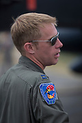 A US Air Force fighter pilot with the 492nd Fighter Squadron stands in front an aircraft at the Farnborough Airshow, on 18th July 2018, in Farnborough, England.