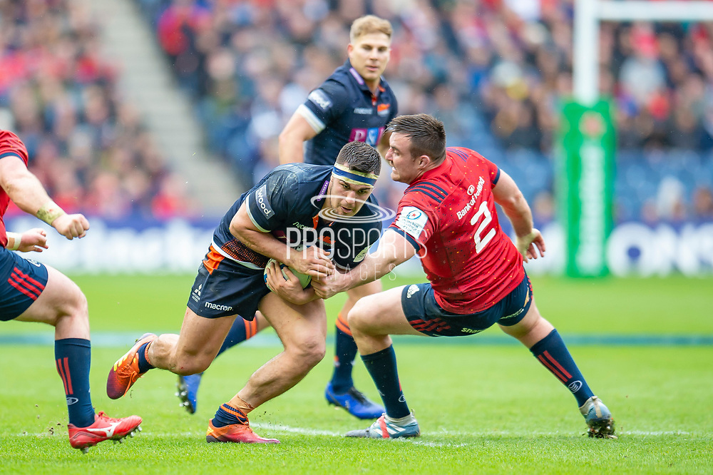 Stuart McInally (#2) of Edinburgh Rugby runs inside Niall Scannell (#2) of Munster Rugby during the Heineken Champions Cup quarter-final match between Edinburgh Rugby and Munster Rugby at BT Murrayfield Stadium, Edinburgh, Scotland on 30 March 2019.