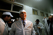 Cavaco Silva dressed with hygienic uniform visits a fruit company.